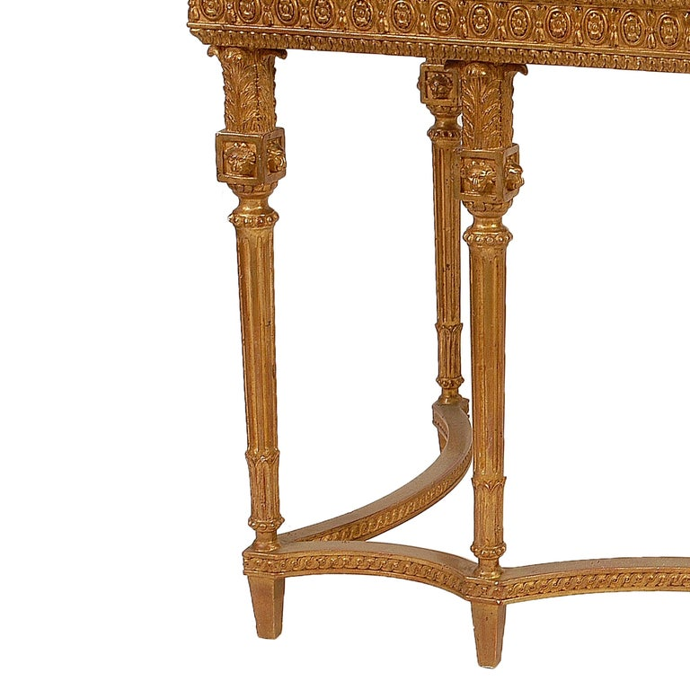 Neoclassical style console hand carved wooden structure with gold foil finished, Spain, 1970. Top in Calacatta Viola marble.