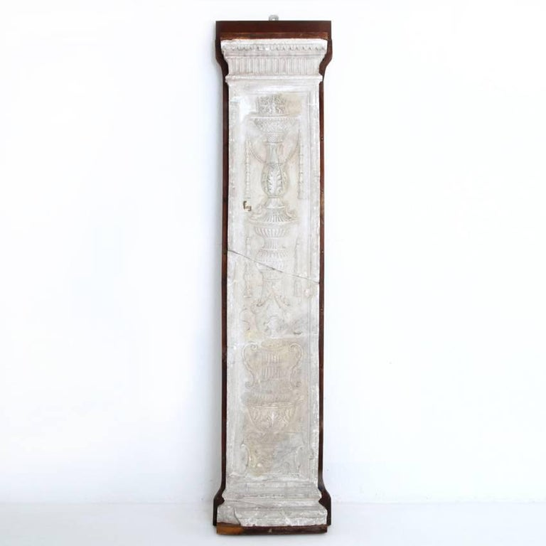 Pilaster mounted on wooden board out of plaster. The pilaster shows a fine neoclassical style relief.