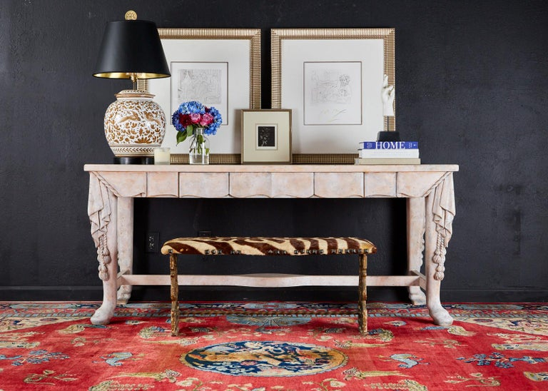 Magnificent library table, writing table, or desk featuring a neoclassical style Trompe l'oeil carved finish. Large trestle style bespoke desk decorated with a faux swag frieze depicting a draped material with ropes and tassels on the corners. The