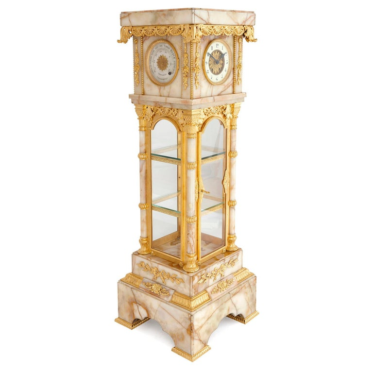 Neoclassical style white onyx and gilt bronze pedestal clock and barometer French, late 19th century Height 150cm, width 52cm, depth 52cm  This fine and large multi-purpose free-standing antique is made from a veined white onyx case with ormolu