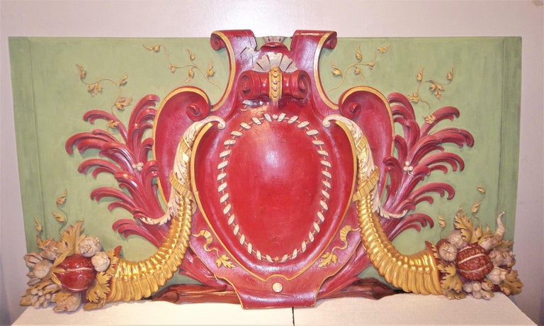 Paneling or boiseries overdoor (maybe a ballroom panel)with a cranberry red ground cartouche against overall French chalky lemon green panel. Central panel flanked by palm fronds and two gilt toned cornucopia with flowers , fruits and vegetables in