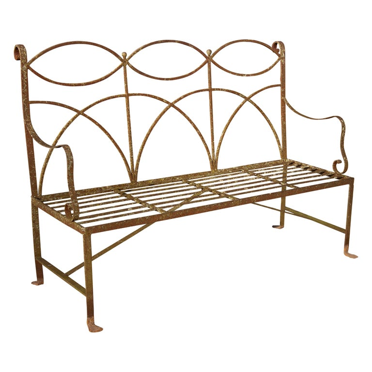 Wrought iron neoclassical garden bench. Simple elegant lines. Wonderful weathered surface. Handmade, circa 1900s-1920s. Seats four. Structurally sound.