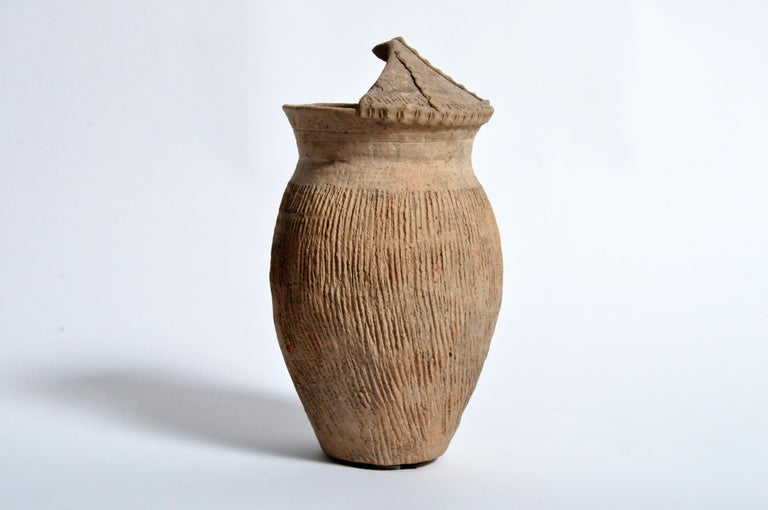 Northern China has a settled history that goes back more than 5,000 years. All along the western reaches of the Yellow River settlements sprung up and some of the first evidence we have is in the form of pottery. This terra cotta vessel was buried