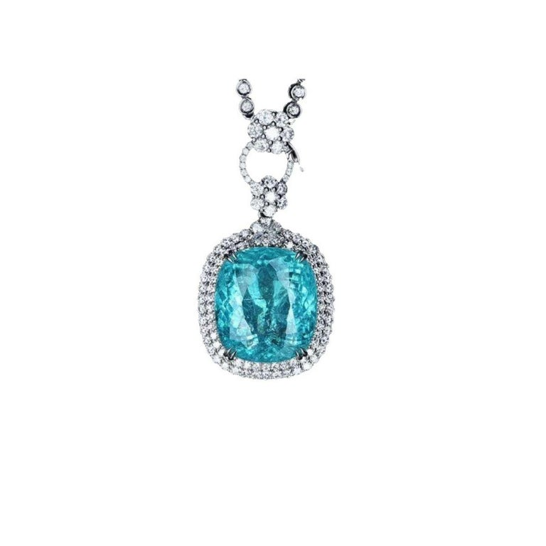 This is a Extremely rare Neon Blue Paraiba Tourmaline Necklace  20.17 ct  with 90 diamonds set in 18k White Gold   The story of this neon-bright tourmaline's discovery is as intriguing as the stone itself. Hidden for many years beneath hills in the