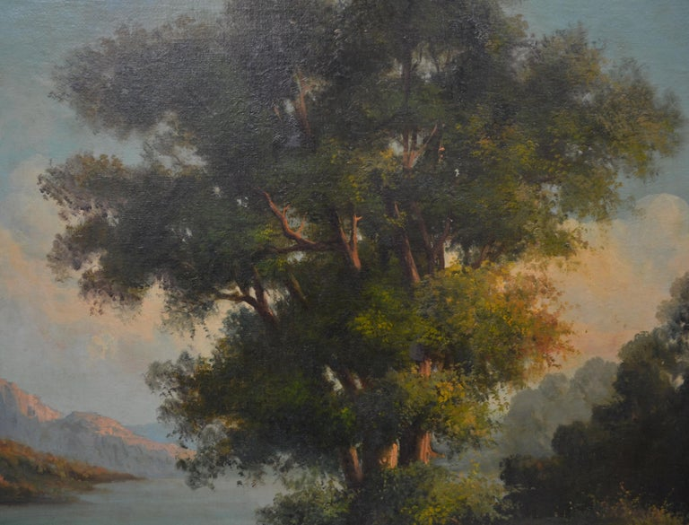 Neopolitan School, 19th century oil on canvas landscape centred around a huge tree and pastoral scene depicting two figures with pair of horned goats near an expansive lake surrounded by tall mountain peaks amid the dawning of a new day. Signed G