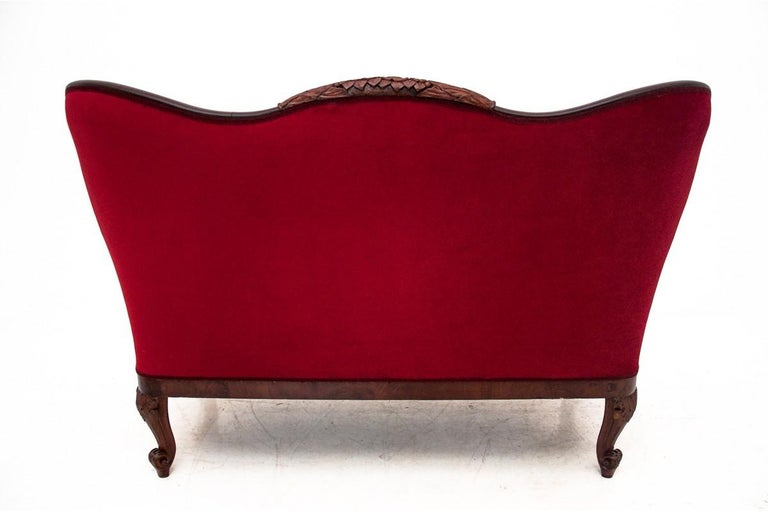 Antique sofa from the late 19th century. Furniture in very good condition, after professional renovation, upholstered with new fabric.  Dimensions: height 103 cm, seat height 48 cm, width 158 cm, depth 78 cm.