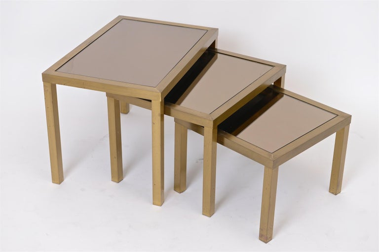 Brass tables with bronze mirror.  Size is for largest table.