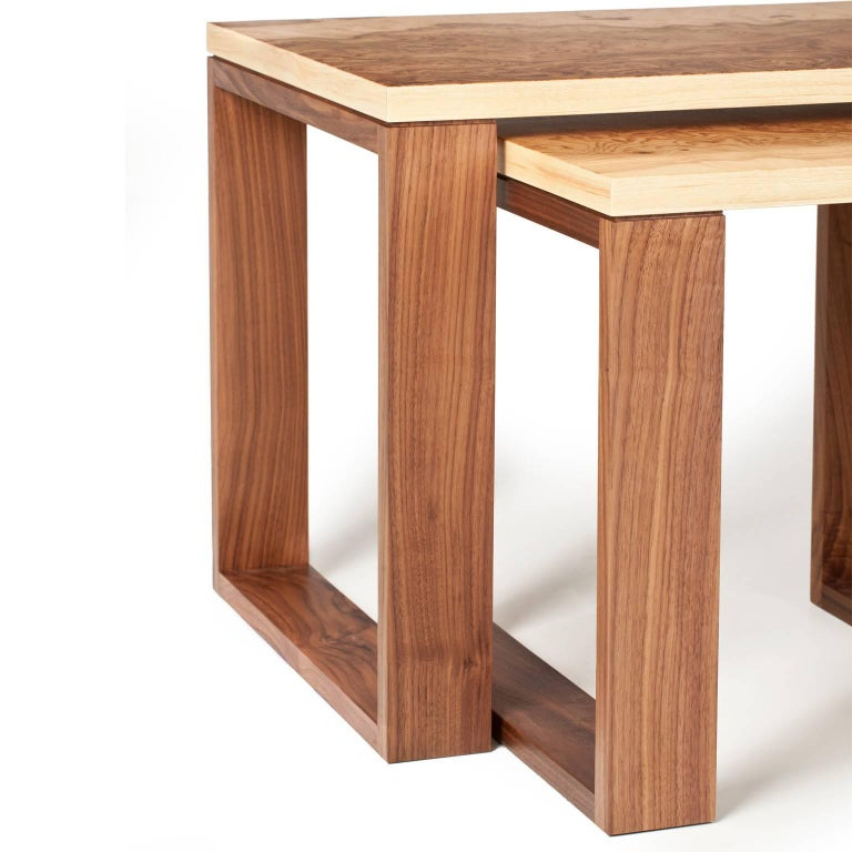 Modern nest of three tables in walnut and highly figured burr olive ash.