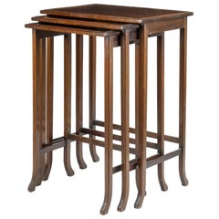 Nest of Three Mahogany Tables, by Waring and Gillow