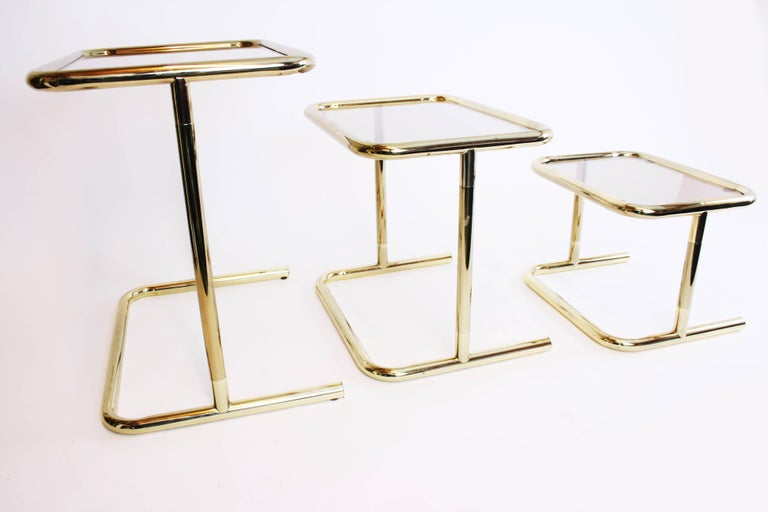 Mid-Century Modern Nesting Table Set Attributed to Design Pierre Cardin, Brass Smoked Glass, France For Sale