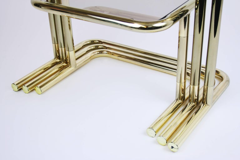 French Nesting Table Set Attributed to Design Pierre Cardin, Brass Smoked Glass, France For Sale
