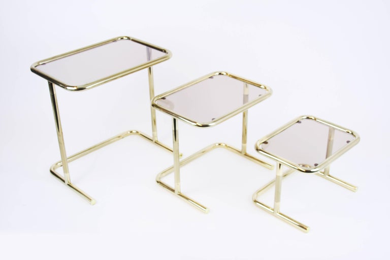 Gilt Nesting Table Set Attributed to Design Pierre Cardin, Brass Smoked Glass, France For Sale