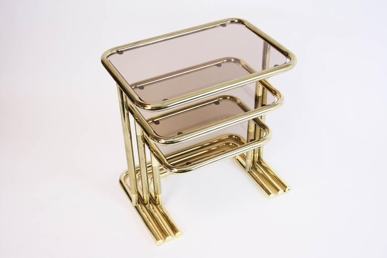 Late 20th Century Nesting Table Set Attributed to Design Pierre Cardin, Brass Smoked Glass, France For Sale
