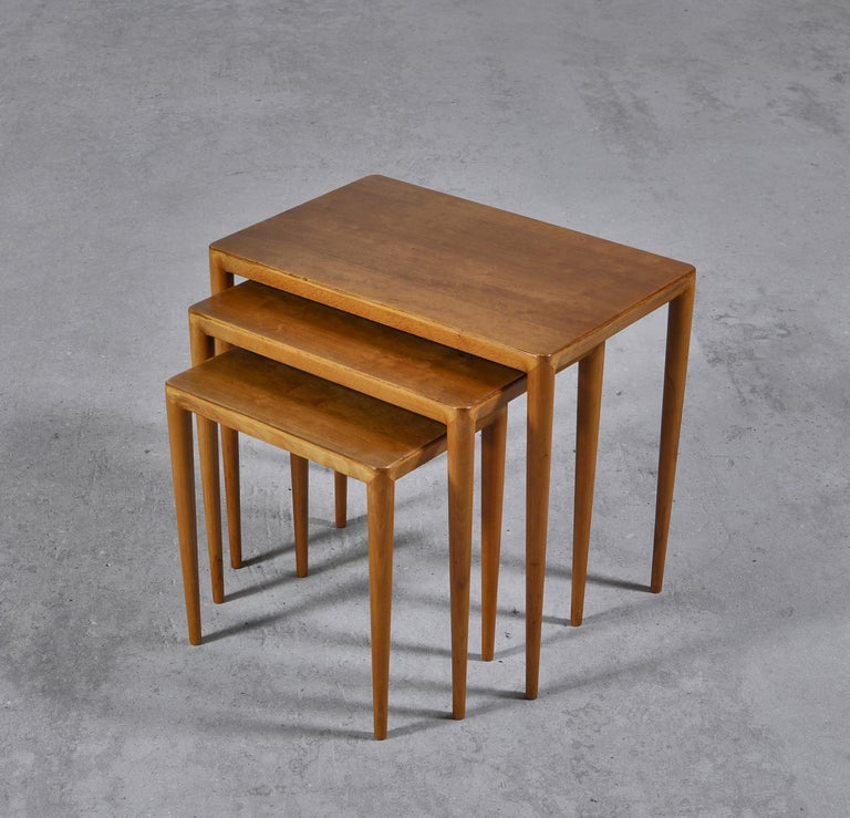 Rare set of vintage Scandinavian Modern nesting tables in birchwood and beech by Erik Severin Risager-Hansen. The skillfully crafted tables features subtle details such as the soft rounded edges and the wonderful warm grain of the birch veneer. The