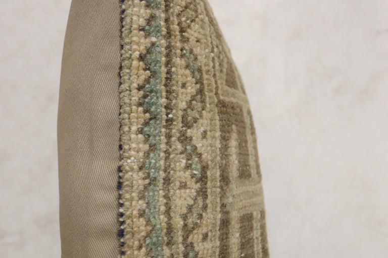 Pillow made from a Turkish Oushak rug. Tan brown and green accents.  Measures: 16