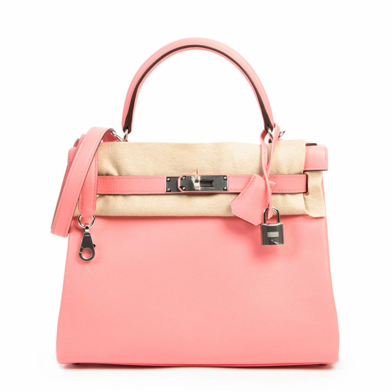 Never Used Hermes Kelly 28 Evercolor Rose D'été & Rouge Exotique Lining PHW  This stunning and eyecatching Kelly bag by Hermès comes in 'Rose d'Eté' evercolor leather and  contrasting Rose Exotique lining.  Summer Rose is a sweet light pink in a