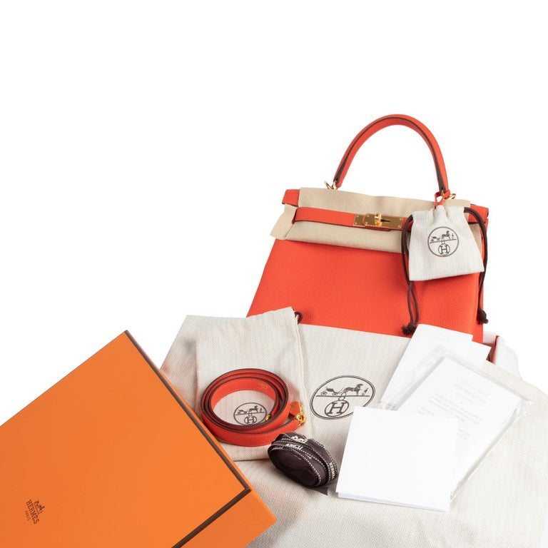 Never Used  Hermes Kelly 28 TogoCapucine GHW  Adding a colourful splash to the palette, this capucine is an alternative to the classic Hermèscolors.'Capucine' is a very light shade of red with pink undertones.  This Hermes Kelly is a real