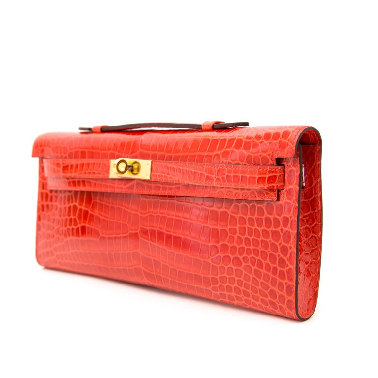 *Never Used* Hermès Kelly Cut pochette crocodile porosus lisse orange  In New Condition For Sale In Antwerp, BE