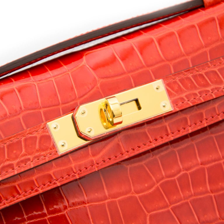 Women's *Never Used* Hermès Kelly Cut pochette crocodile porosus lisse orange  For Sale