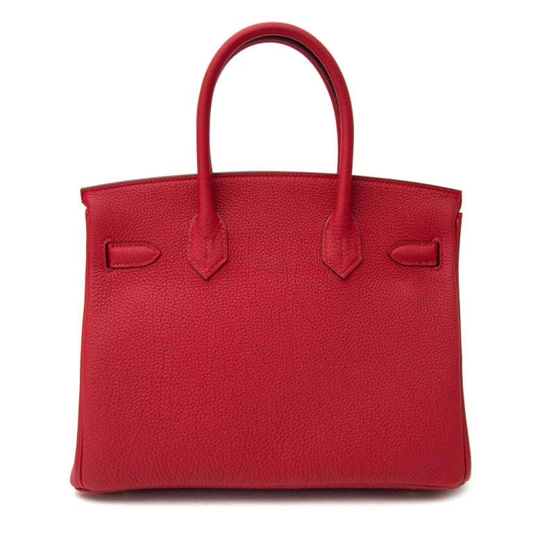 Never Used  Hermès Birkin 30 Togo Rouge Vif GHW  Skip the waitinglist and get this beauty right now! This Hermès Birkin comes in a deep red togo leather named 'Rouge Vif'.  Togo leather is known for its grainy but smooth texture. It's almost 100 %