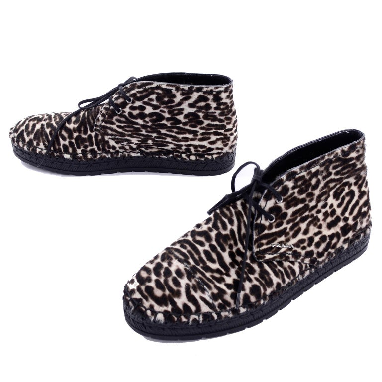These Prada Calzature Donna lace up ankle shoes or booties have never been worn! They are in a leopard print pony hair and have 4 eyelets per shoe, with black laces. These fabulous shoes are made in the style similar to moccasins and have black