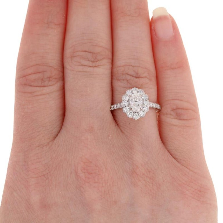 Women's 1.19 Carat Oval Cut Diamond Halo Engagement Ring, 18 Karat White Gold Floral GIA For Sale