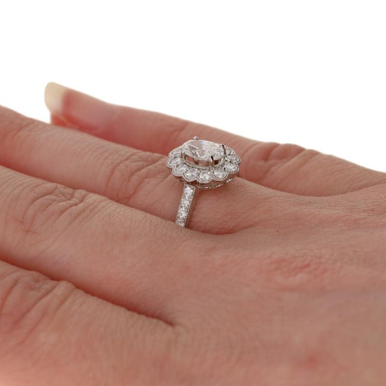 1.19 Carat Oval Cut Diamond Halo Engagement Ring, 18 Karat White Gold Floral GIA For Sale 1
