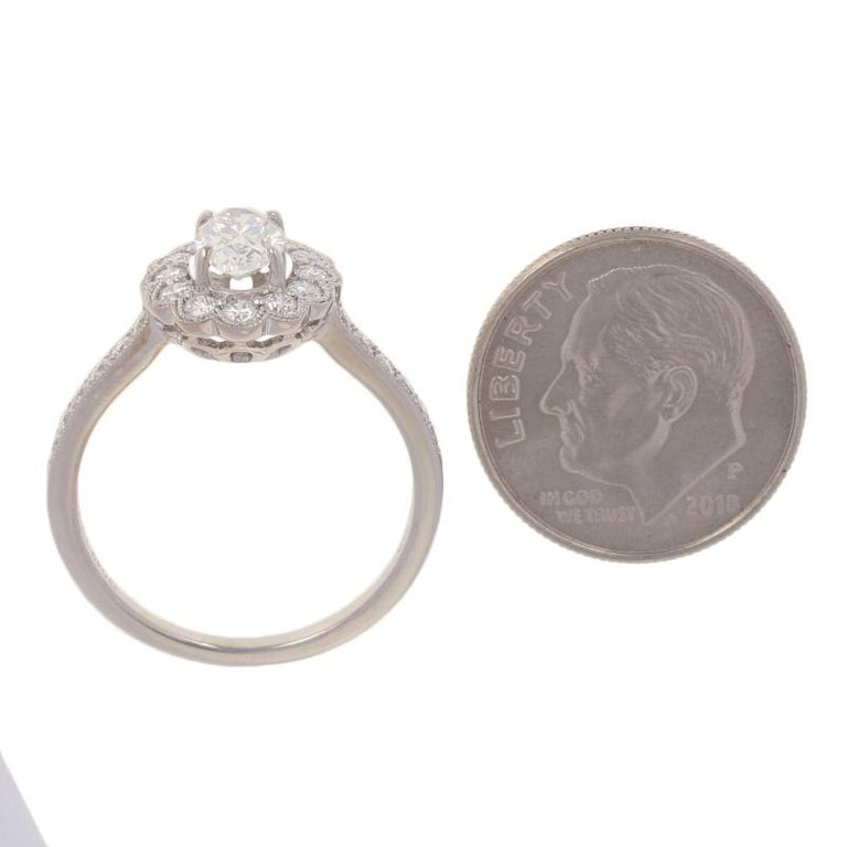1.19 Carat Oval Cut Diamond Halo Engagement Ring, 18 Karat White Gold Floral GIA For Sale 2