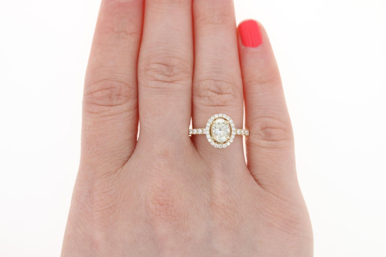 1.47 Carat Oval Cut Diamond Engagement Ring, 14 Karat Yellow Gold GIA Halo In New Condition For Sale In Greensboro, NC