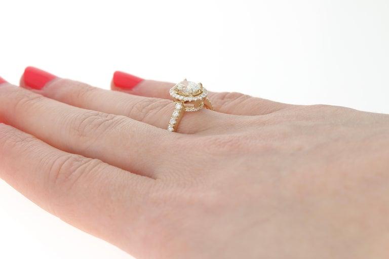 Women's 1.47 Carat Oval Cut Diamond Engagement Ring, 14 Karat Yellow Gold GIA Halo For Sale