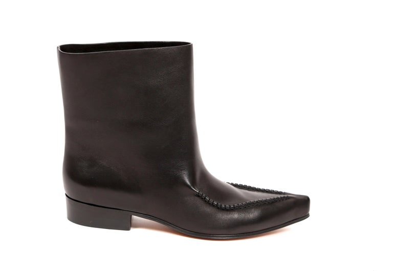Black leather 'Santiag' ankle boots designed by Phoebe Philo for Celine exactly as seen on the fall 2017 runway. French size 40.5. Pointed toe. Pull on style. Approximate heel height is .75