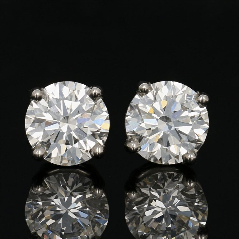 With the gift of diamonds, you can say it all without saying a word! Crafted in 950 platinum, these luxurious NEW stud earrings feature GIA-graded natural diamonds held in four-prong basket mounts to illuminate each gemstone's spectacular