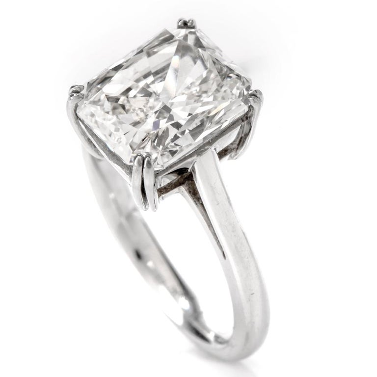 Looking to propose or for a way to say I Love You, LOOK NO FURTHER!!!  Dazzle the love of your life with this mesmerizing  5.03 carat, GIA certified, rectangular Radiant shaped Diamond solitaire.  The high quality and color of this diamond is sure