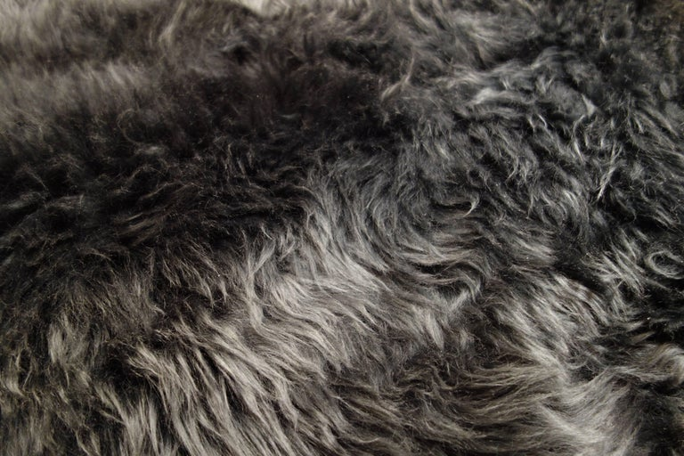 A new 6 ft. sumptuous charcoal gray sheepskin rug. Sold individually: five available.