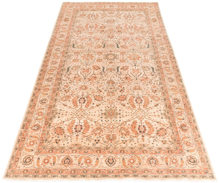 This transitional handwoven rug is an updated version of traditional oriental rugs with more subtle colors and a neutral field. The blend of traditional and contemporary elements offers versatility for any home.