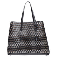 new ALAIA black leather gunmetal grommet punctured expandable large tote bag