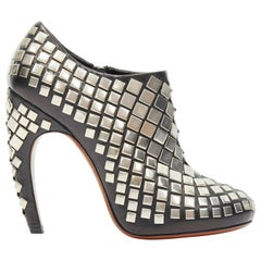 new ALAIA black leather silver square stud embellished curved heel bootie EU38