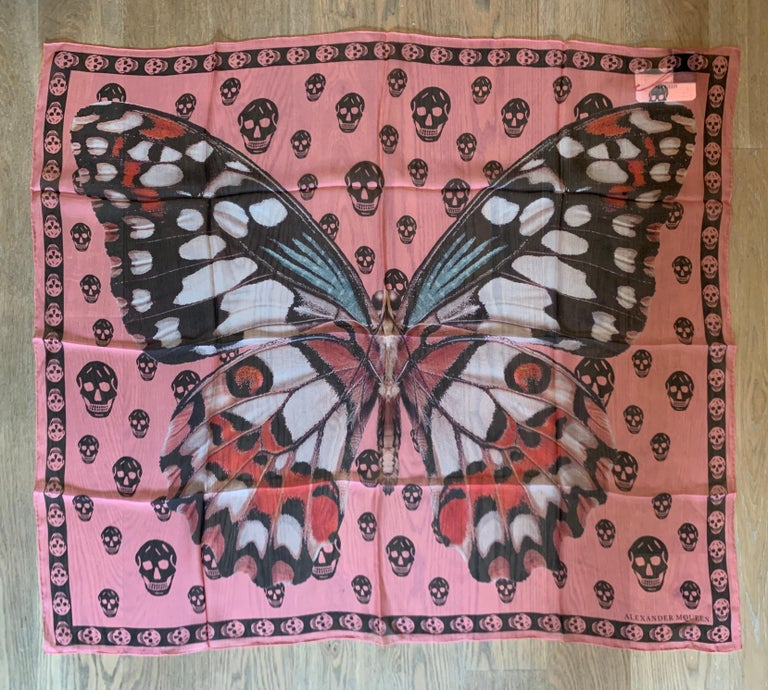 New Alexander McQueen large semi-sheer scarf featuring giant butterfly or moth with black skull print throughout background. Signed Alexander McQueen in logo at bottom corner.   Purchased directly from McQueen store.  100% silk.  Approximately 41