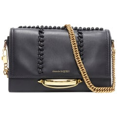 new ALEXANDER MCQUEEN The Story black leather whipstitch gold knuckle chain bag