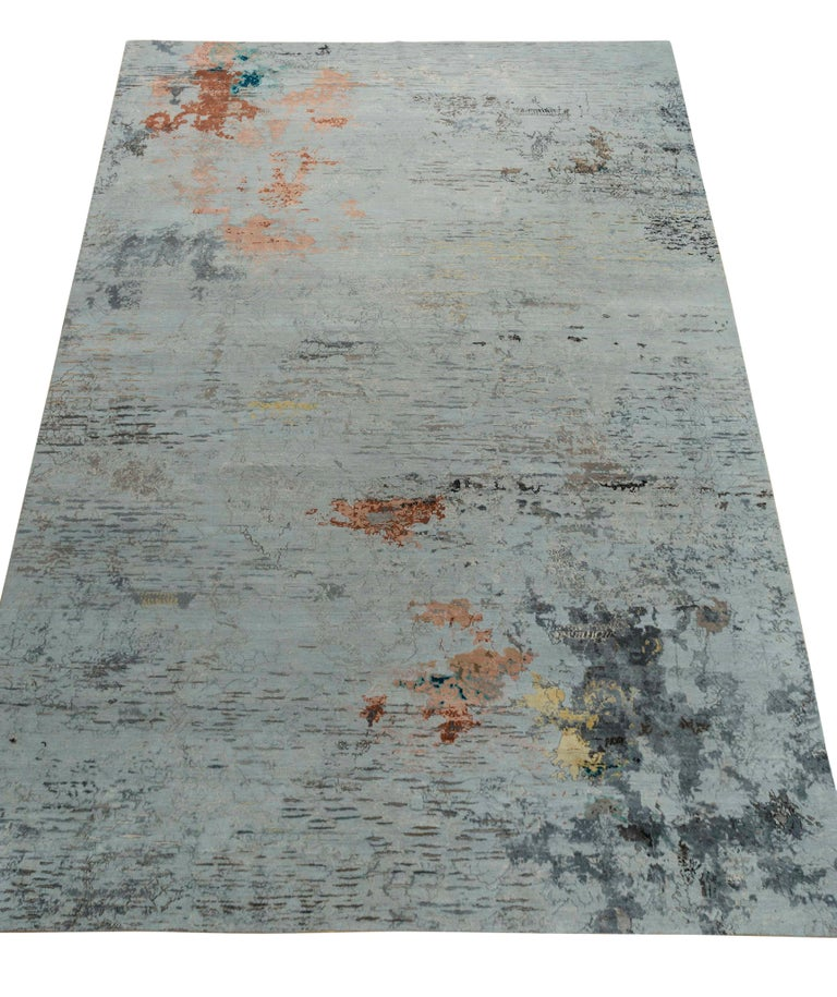 New area rug handwoven from the finest sheep's wool and real silk. It's colored with all-natural vegetable dyes that are safe for humans and pets. It features beautiful modern watercolor art design patterns that blend perfectly with contemporary