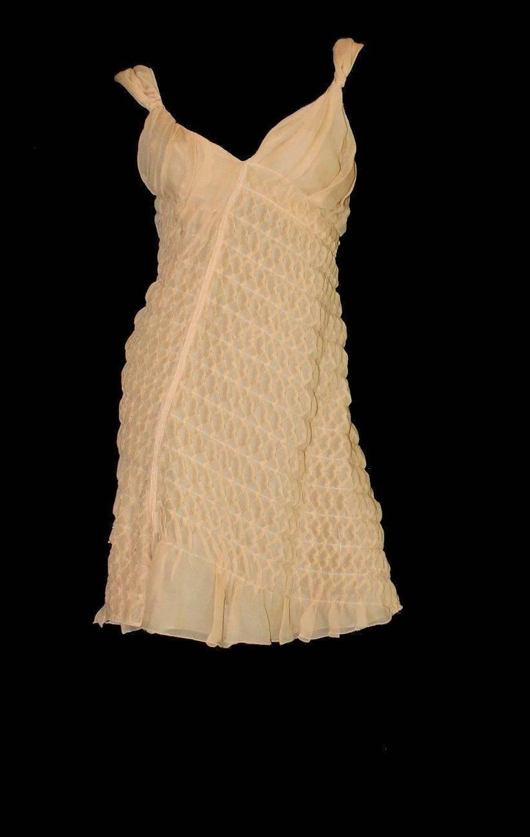 Stunning PRADA dress Just like couture - hand-sewn by the seamstresses in Prada's atelier of the finest chiffon silk existing Asymmetric cut 3D ruched honeycomb details for a great look   Closes with invisible snap fasteners    Frayed details