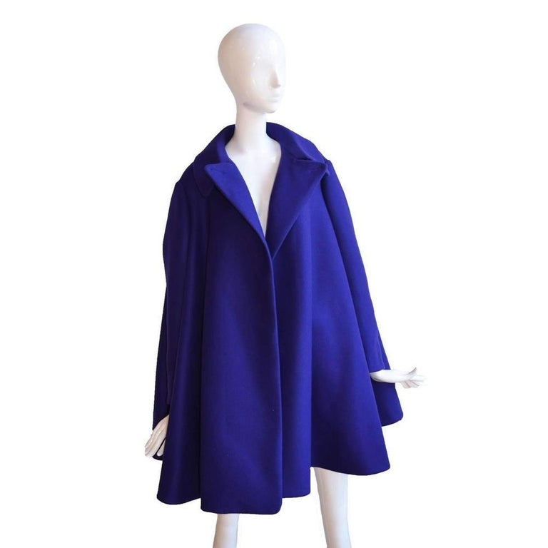 Step out into the open with this bold cape coat from Azzedine Alaïa that will shield you from strong winds with its bountiful silhouette. Delectably enveloping, this felted wool piece can be worn over any ensemble with its roomy form. Steer clear