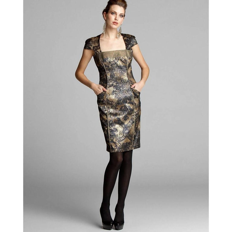 Badgley Mischka Dress Brand New with Tags * STUNNING * Size: 4 * Two Side Pockets * Metallic Gold & Black Flower Print * Cap Sleeves & Square Neck * Fully Lined * Center Back Zipper & One Button Closure * 79% Polyester     21% Cotton  We are happy