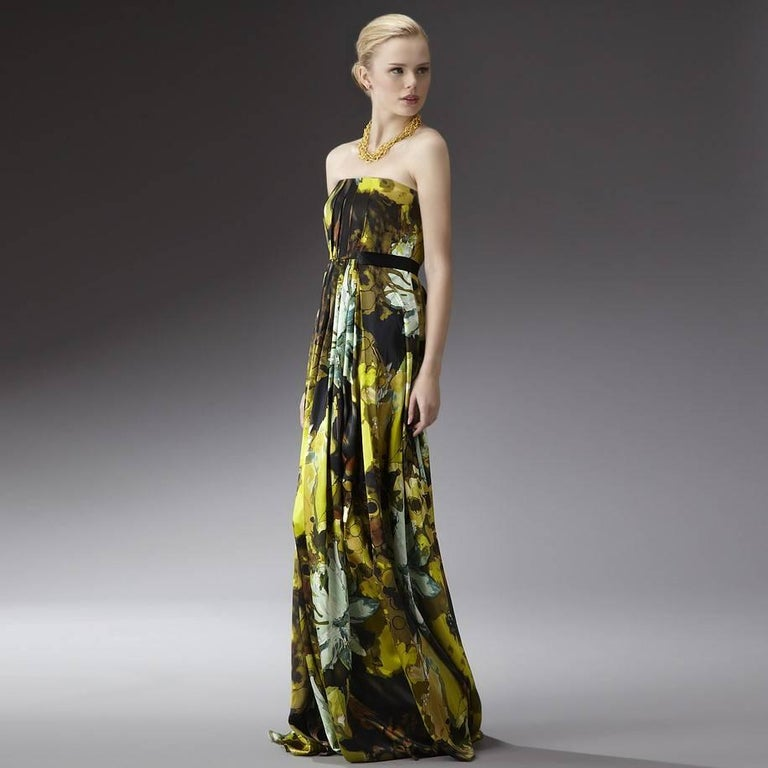 Badgley Mischka Gown Size: 4 Brand New with Tags * 100% Silk * Stunning Multi Print  * Fully Lined * Hidden Zipper & Hook Closure * Sash Ties at Back * Boning at Bodice for Support We are happy to provide measurements upon request