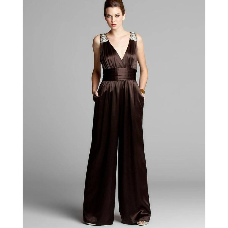 Badgley Mischka Jumpsuit Stunning! Size: 6 * 100% Silk * Rhinestone jewel details on shoulders * Banded waist with horizontal pleats  * Center back zipper closure * Flowy loose fit through legs * Two Hidden Side Pockets * Chocolate Brown We are