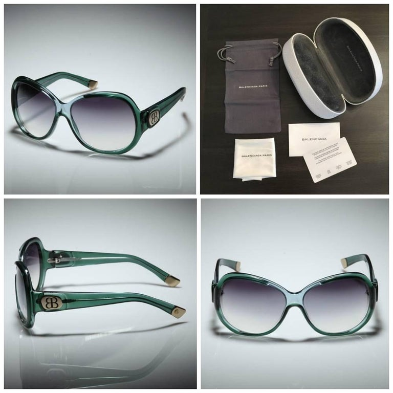 """Balenciaga Sunglasses Brand New * Stunning Slightly Mirrored Lenses * Light & Dark Emerald Frames * Frame Width 6.5"""" * Frame Height 2.25"""" * BB Gold Details on Temples * Made in Italy * 100% UVA/UVB Protection * Comes with Balenciaga Hard Case, Soft"""