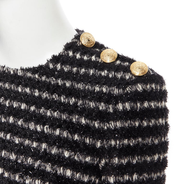 new BALMAIN black white stripe fluffy tweed knit military button mini dress Fr34 Brand: Balmain Designer: Olivier Rousteing Model Name / Style: Stripe dress Material: Polyester blend Color: Black, white Pattern: Striped Closure: Zip Extra Detail: