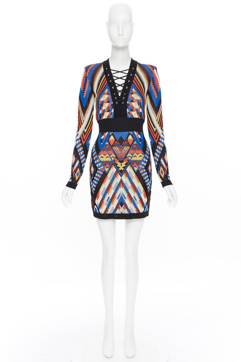 new BALMAIN Runway ethnic tribal knitted lace V-neck bodycon mini dress FR36 S Brand: Balmain Designer: Olivier Rousteing Model Name / Style: Bodycon dress Material: Viscose Color: Multicolour Pattern: Geometric Closure: Zip Extra Detail: BALMAIN