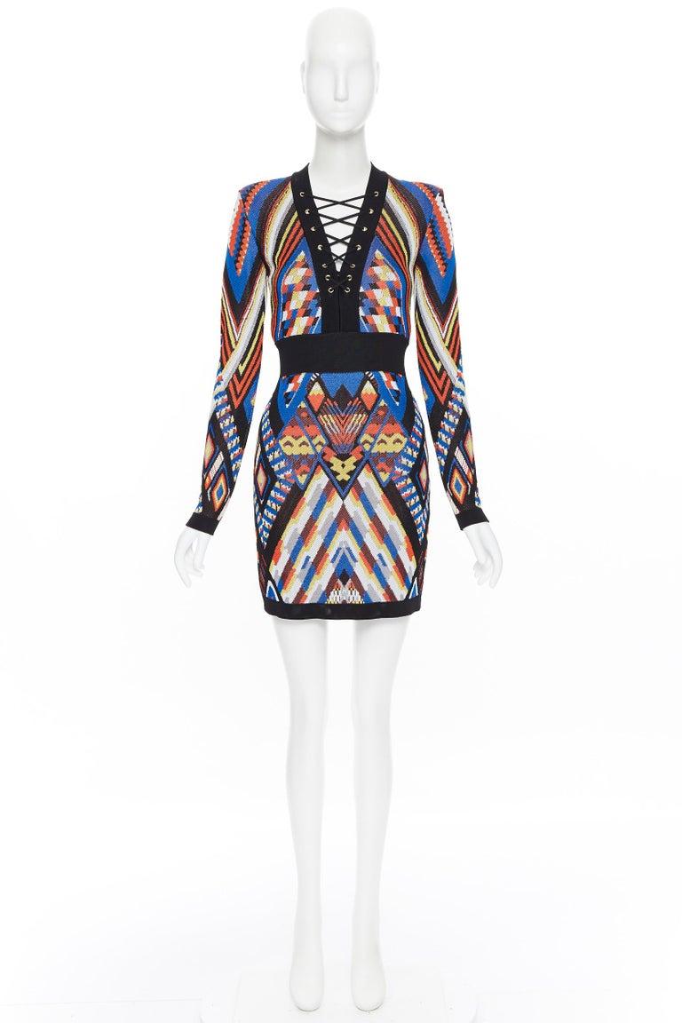 new BALMAIN Runway ethnic tribal knitted lace V-neck bodycon mini dress FR38 M Brand: Balmain Designer: Olivier Rousteing Model Name / Style: Bodycon dress Material: Viscose Color: Multicolour Pattern: Geometric Closure: Zip Extra Detail: BALMAIN