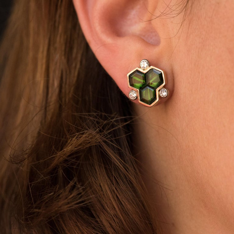 Baume Creation - Unique piece. Pair of ear studs in 18 karats yellow gold. Each ear stud is adorned, in closed setting, with three ultra flat hexagonal green tourmaline. The entourage is punctuated with 3 brilliant- cut diamonds. The attachment
